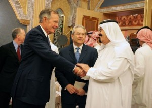 Former President George H.W. Bush shakes hands with King Abdullah in 2005. [via White House Archives]