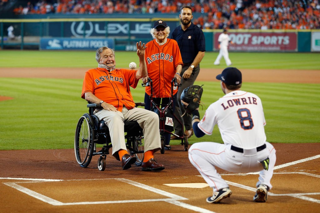 HOUSTON, TX - OCTOBER 11:  Former President George H.W. Bush throws out the ceremonial first pitch to Jed Lowrie #8 of the Houston Astros as former First Lady Barbara Bush looks on prior to game three of the American League Division Series between the Houston Astros and the Kansas City Royals at Minute Maid Park on October 11, 2015 in Houston, Texas.  (Photo by Bob Levey/Getty Images)